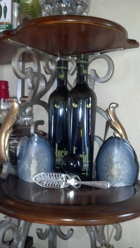 lucid absinthe two bottles and spoon