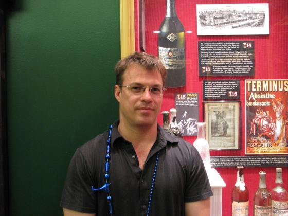 Ted Breaux in Front of Absinthe Display at Museum of American Cocktail 1
