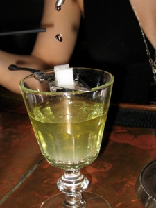 slow louche from absinthe fountain