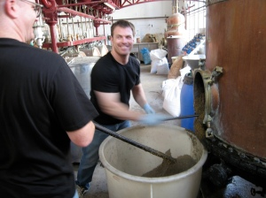 Ted scooping out depleted herbs after distillation of Lucid… all the good stuff from those fresh herbs went right into your bottles